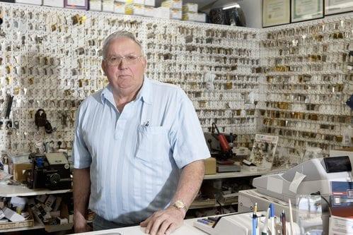 Portrait of locksmith in store